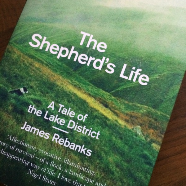 green English hillsides on the cover of The Shepherd's Life