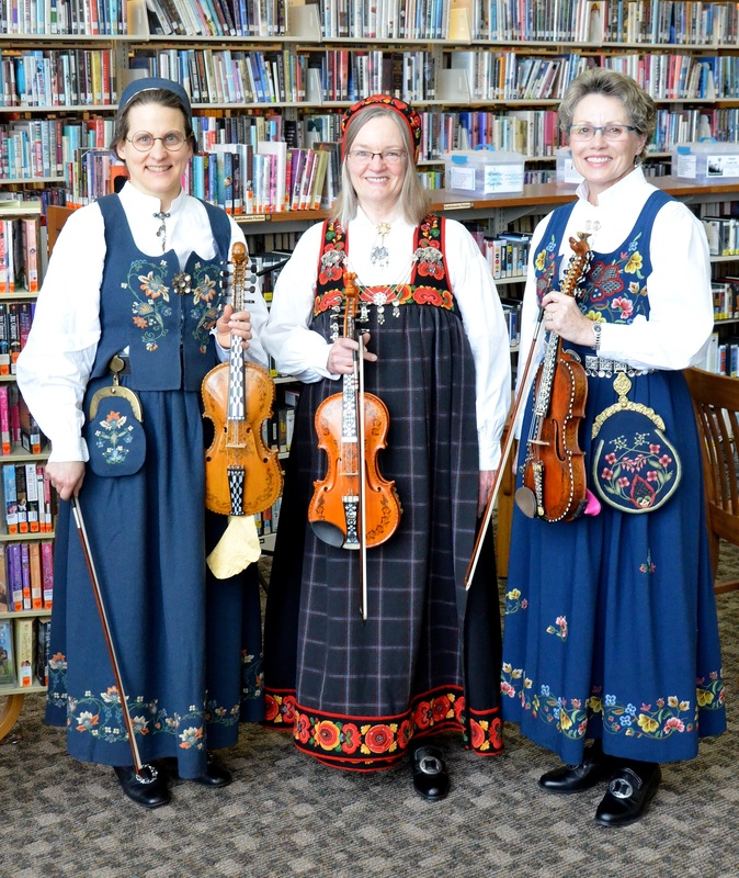 Ladies of the Fjord musicians in traditional dresses