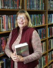 picture of Mary Friesen holding a book
