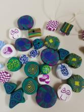 polymer clay beads in various shapes and colors