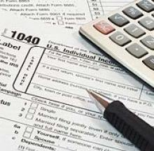 tax forms, with pen and calculator