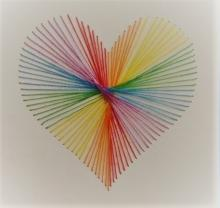 rainbow string art in the shape of a heart