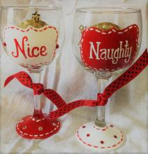 "wine glasses painted with ""naughty"" and ""nice"""